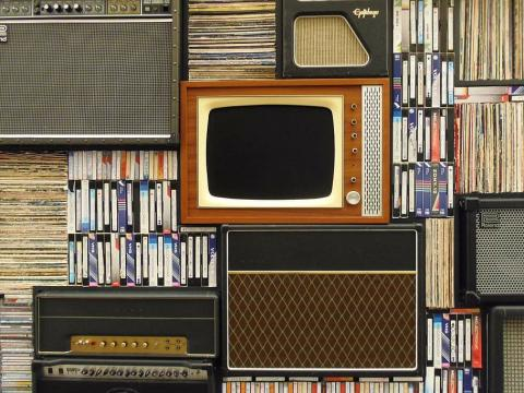 Old TV, VHS tapes, cassette tapes, records